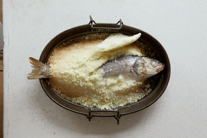 Recipe for sea bass, baked in a salt crust and served with a chicory and orange salad